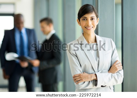 happy young indian businesswoman in modern office - stock photo