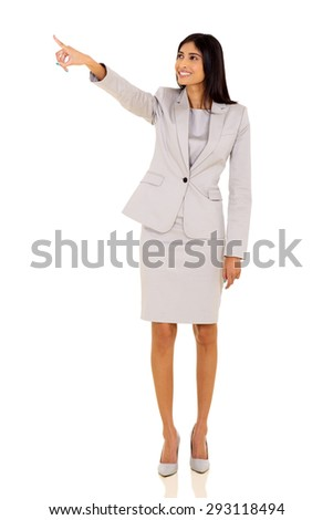 happy young indian businesswoman pointing at empty copy space - stock photo