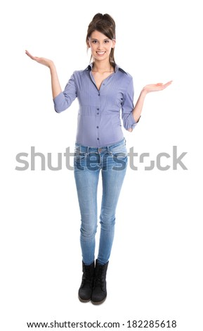 Happy young isolated woman is presenting with both hands.