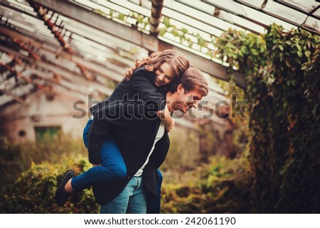 Happy young joyful couple having  - stock photo