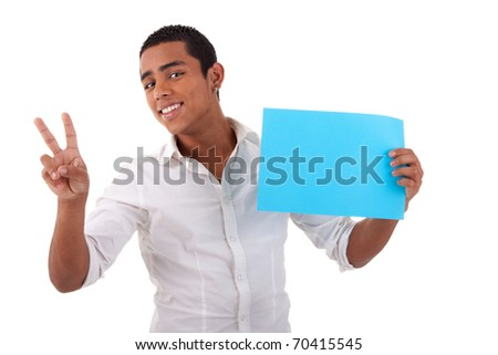happy young latino man, with blue card in hand, fingers as sign of victory, isolated on white background. Studio shot.
