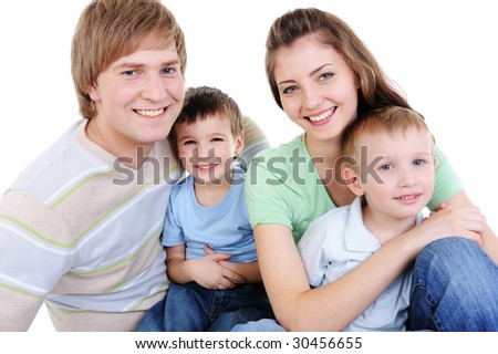 happy young laughing family with two little sons - white background