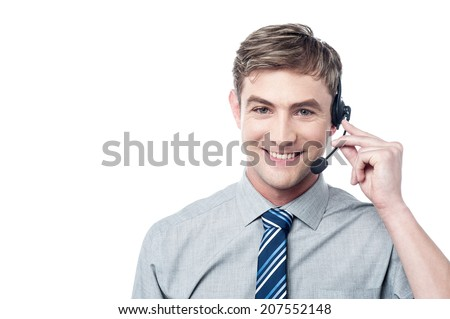 Happy young male customer support executive - stock photo