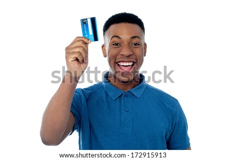 Happy young man displaying his cash card