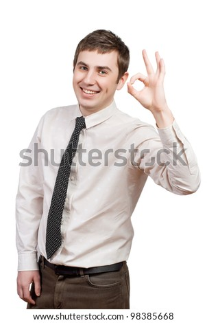 Happy young man doing the ok sign over white background - stock photo