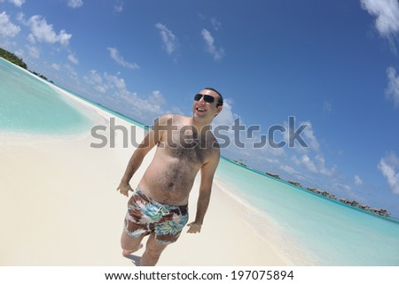 happy young man have fun and relax on beach