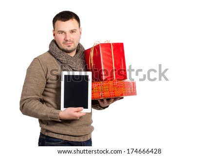 Happy young man holding a lot of boxes with gifts, isolated on white. Man with emotion holding a gift box and electronic tablet. Man with red gift box and i pad on a white background. - stock photo