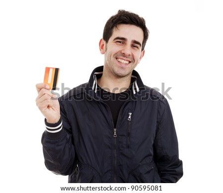 Happy young man holding credit card on white - stock photo