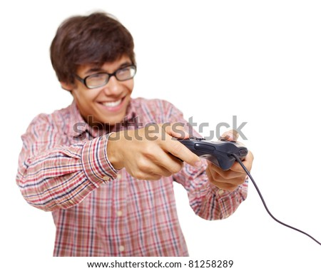 Happy young man in glasses playing video game with joystick over isolated background, focus on joystick. Mask included - stock photo