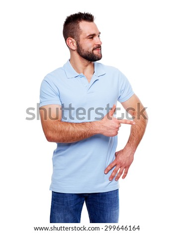 Happy young man in polo shirt showing empty copyspace - stock photo