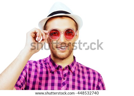 Happy young man in stylish bright clothes and sunglasses smiling at camera. Summer fashion. Isolated over white. - stock photo