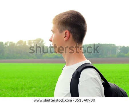 Happy Young Man in the Summer Field - stock photo