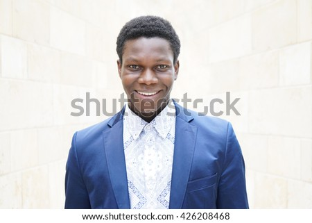 happy young man of african descent with toothy smile - stock photo