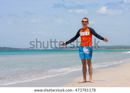 Happy young man on a wonderful tropical beach