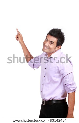 Happy young man pointing to blank space, smiling. isolated on white - stock photo