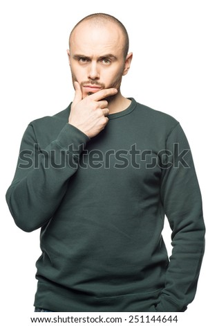 Happy young man pointing up  and looking away. Isolated on white background. - stock photo