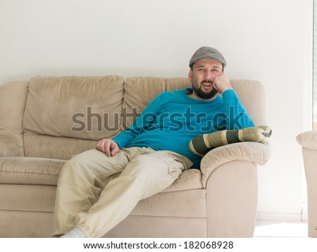 happy young  man  relaxing at bright home livingroom - stock photo