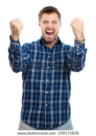 Happy young man shouting with arms up against white background - stock photo