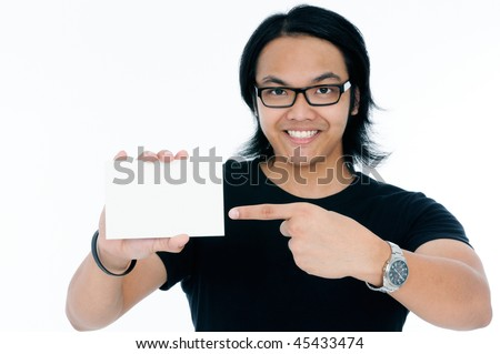 Happy young man showing a blank business card.
