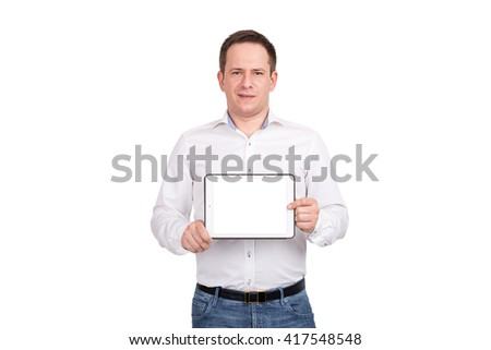Happy young man showing blank tablet computer screen over white background. Looking at camera - stock photo