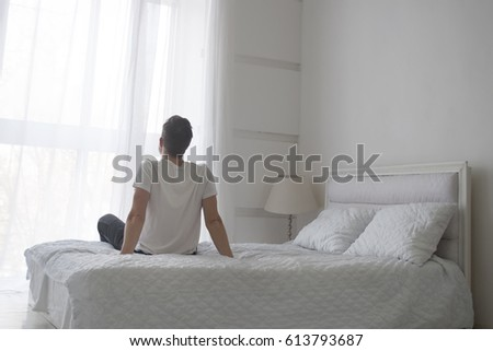 Man sitting on bed stock images royalty free images for Beds that sit up