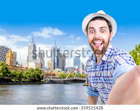 Happy young man taking a selfie photo in Melbourne, Australia - stock photo