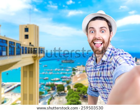 Happy young man taking a selfie photo in Salvador, Bahia - stock photo