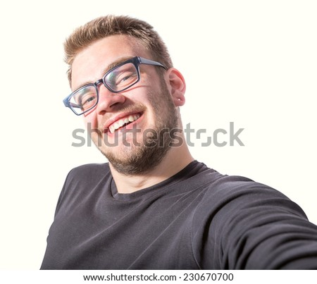 Happy young man taking a selfie photo. Isolated on white background - stock photo
