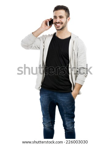 Happy young man talking on cell phone isolated on white background - stock photo