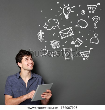 Happy young man using digital tablet for multimedia concept - stock photo