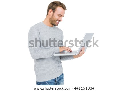 Happy young man using laptop on white background