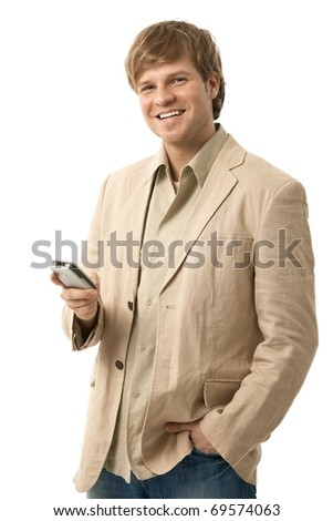 Happy young man using mobile phone, looking at camera, smiling. Isolated  on white.? - stock photo