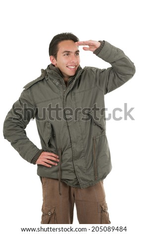 happy young man wearing green jacket posing looking with hand on his forehead isolated over white - stock photo