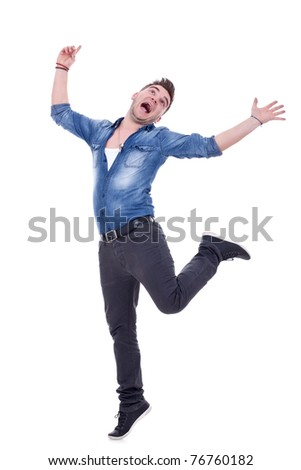 Happy young man with arms up , fooling around, isolated on a white background