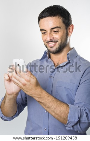 Happy Young Man with Beard texting on Cellphone isolated on White Background - stock photo