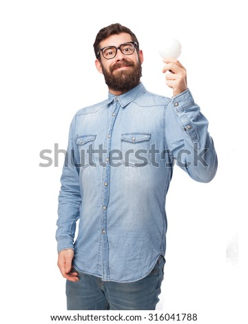 happy young man with bulb - stock photo
