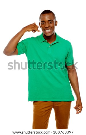 Happy young man with calling gesture over white background