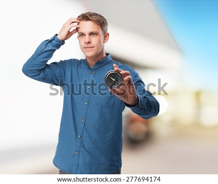 happy young-man with compass - stock photo