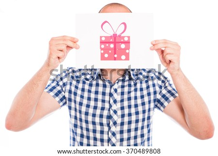 Happy young man with gift box sign - stock photo