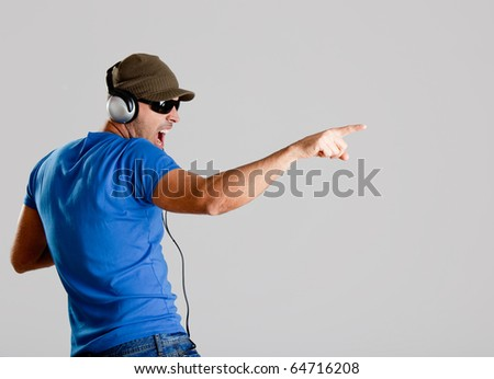 Happy young man with headphones listening music