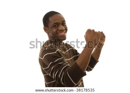 Happy young man with his arm up celebrating something - stock photo