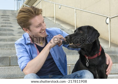 Happy young man with his dog, Outdoor