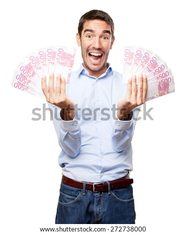 Happy young man with lots of money - stock photo