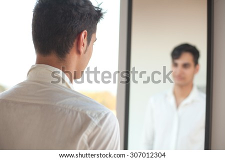 happy young man with mirror - stock photo