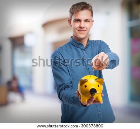 happy young-man with piggy-bank - stock photo