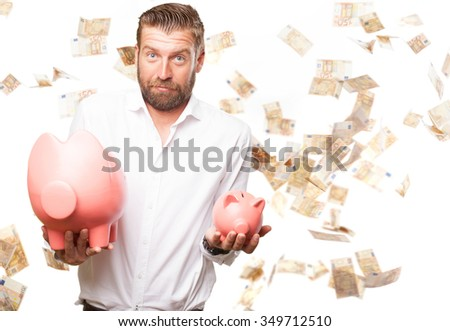 happy young man with piggy bank - stock photo