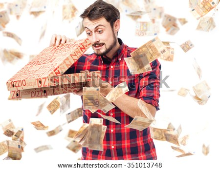 happy young man with pizza box - stock photo