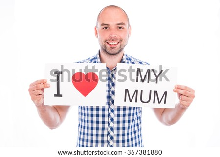 Happy young man with sign I love my mum - stock photo