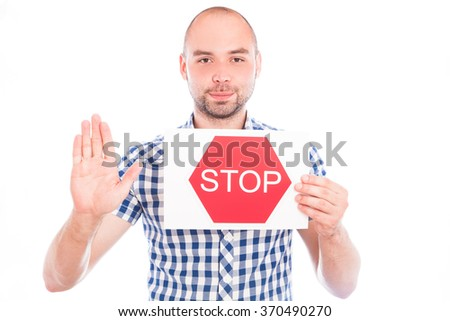 Happy young man with stop sign against the white - stock photo