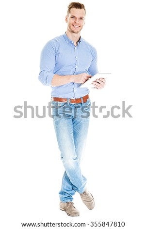 Happy young man with tablet computer - full body isolated